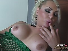 Blonde tranny Afrika with a big dildo in her mouth