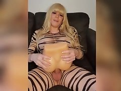 Tiger stripe Jesse's hard cock is in heat and relives her lust by fucking her ass toy