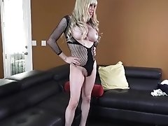 Watch the behind the scenes as Jesse in sexy black fishnet strokes her massive dick in a photoshoot