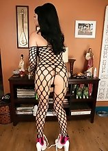 Bailey Jay's hot body, massive tits and pulsating cock is held on by her sexy fishnet outfit