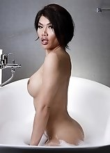 Zena Lynn in a bubbly tub jacking off her dick until she cums hard